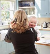 woman working with a baby - stock photo