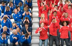Rival fans at football match Stock Photos