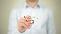 Nuclear Energy,  Man writing on transparent screen Stock Footage