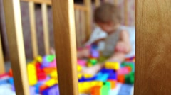 Kids building spaceship with lego bricks in cot - stock footage