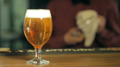 A glass of beer on the table Stock Footage