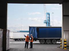 Port Workers Organizing Lorries Stock Photos