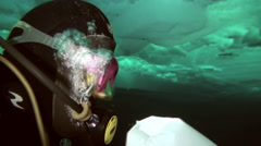 The diver puts sample underwater ice at the North Pole. Stock Footage