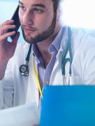 Junior doctor using smartphone in clinic Stock Photos