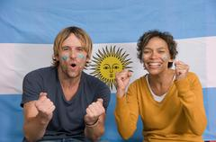 Couple smiling with Argentinian flag Stock Photos