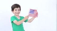 Young boy holding the american flag - stock footage