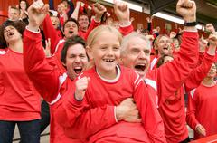 Fans celebrating at football match Stock Photos