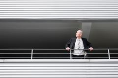 Man leaning out observing Stock Photos