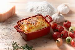 High angle view of lasagne in rectangular casserole dish - stock photo