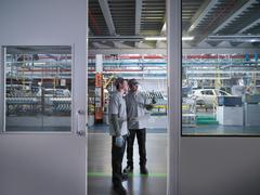 Car Plant Workers In Factory Kuvituskuvat
