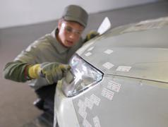 Plant Worker Inspecting Headlight On Car Stock Photos
