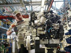 Car Worker Building Car Parts Stock Photos