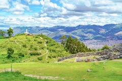 Lanscape of Saqsaywaman with the statue of Jesus Christ - stock photo