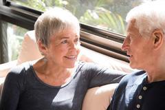 Senior couple, relaxing, sitting face to face Stock Photos