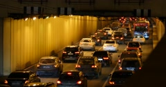 Cars going into tunnel Stock Footage