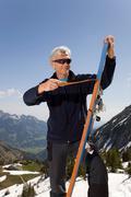 Senior man on ski tour in mountains Stock Photos