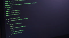 Programming code on a hackers computer screen - stock footage