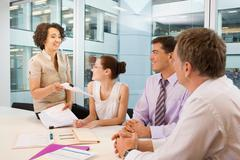 A senior female heads business meeting Kuvituskuvat