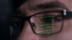 Data code Reflection in Programmers, hackers Glasses Stock Footage