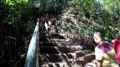 People climbing down on steep stair Stock Footage
