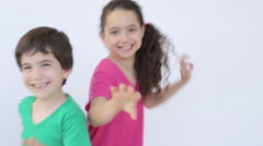 Happy kids smiling and jumping Stock Footage