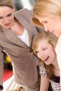 women teaching something to a trainee - stock photo
