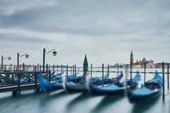Blurred gondolas and distant view of Church of San Giorgio Maggiore, Venice, Stock Photos