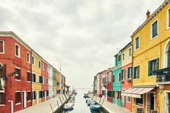 Traditional multi colored houses on canal, Burano, Venice, Italy Stock Photos