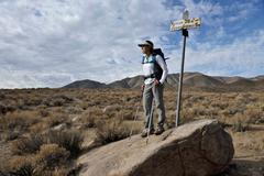 Hiker exploring desert, Cottonwood Canyon, Death Valley National Park, Stock Photos