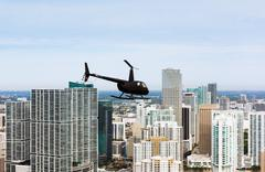 Helicopter and skyscrapers, Brickell, Downtown Miami, Florida, USA Stock Photos