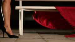 Female Legs and Bench and Red Drape Stock Footage