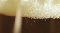 Beer bubbles in a glass Stock Footage