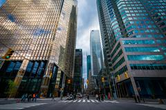 An intersection and modern skyscrapers in downtown Toronto, Ontario. Kuvituskuvat