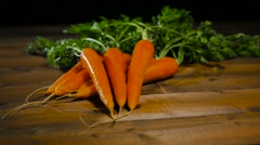 Carrots on rustic wooden table dolly movement Stock Footage