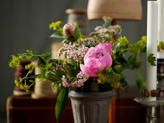 Flower arrangement in front of traditional bobbins - stock photo