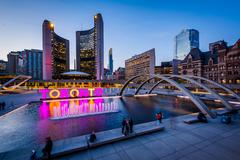View of Nathan Phillips Square and Toronto Sign in downtown at twilight, in T Stock Photos