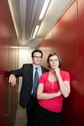 Business couple in a store cupboard Stock Photos