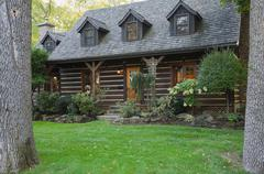 Exterior of Canadian cottage style home with cedar shingles and garden Kuvituskuvat
