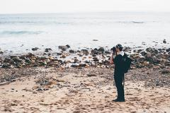 Male photographer photographing from beach, Crystal Cove State Park, Laguna Stock Photos