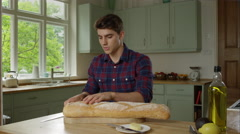 Man prepairing a healthy lunch while at home. Stock Footage