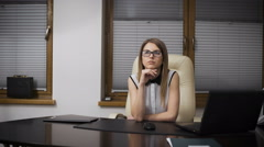 Secretary Girl distracted from work. She sits at a desk and dreaming of vacation - stock footage