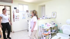 A young girl enters a Private Aesthetic medical beauty clinic Stock Footage