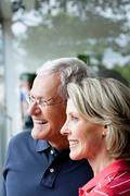 Senior Couple Looking At Window Stock Photos