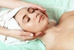 anti aging facial massage - stock photo