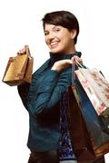Girl with shopping in bags, Shopaholic, Packages with things Stock Photos
