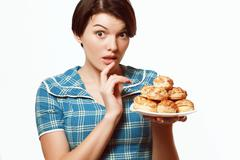 beautiful girl with a plate of bakery products, diet, calories - stock photo