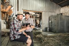 Two scientists comparing data in plant growth research centre barn Stock Photos