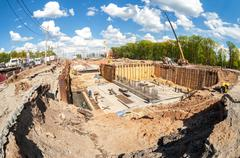 Construction works on the construction of new motorway in summer sunny day Stock Photos