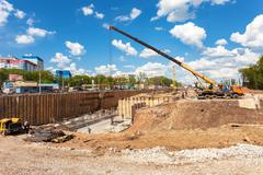 Construction machinery at the construction of new motorway in summer sunny da - stock photo