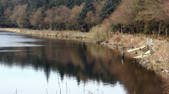 Fly fishing on Entwistle reservoir, Lancashire Stock Footage